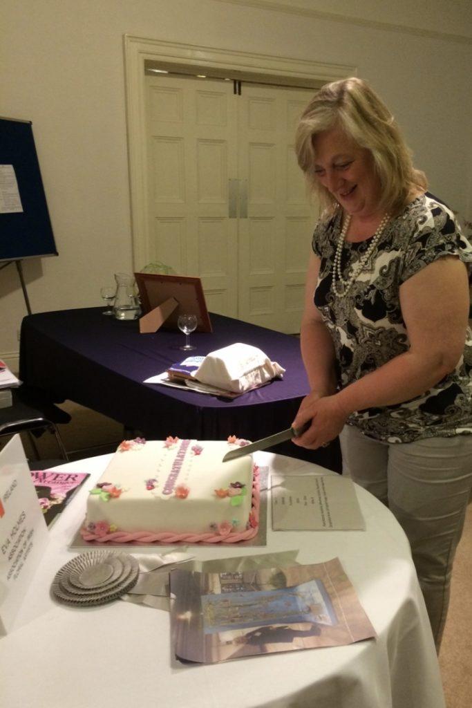 Eva cuts her celebration cake at Kilkenny Flower Club, May 2016